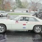 Cream-colored 1988 Jaguar car, side view