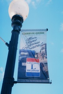 A light post in Franklin Grove sports a new Lincoln Highway sign.