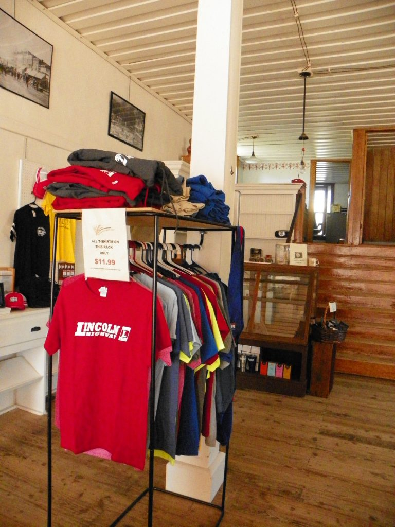 Lincoln Highway shirts for sale on a clothes rack