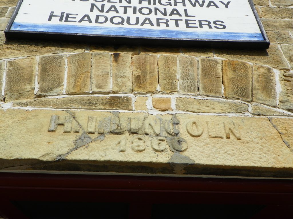 H. I. Lincoln 1860 chiseled out in a light brown limestone lintel
