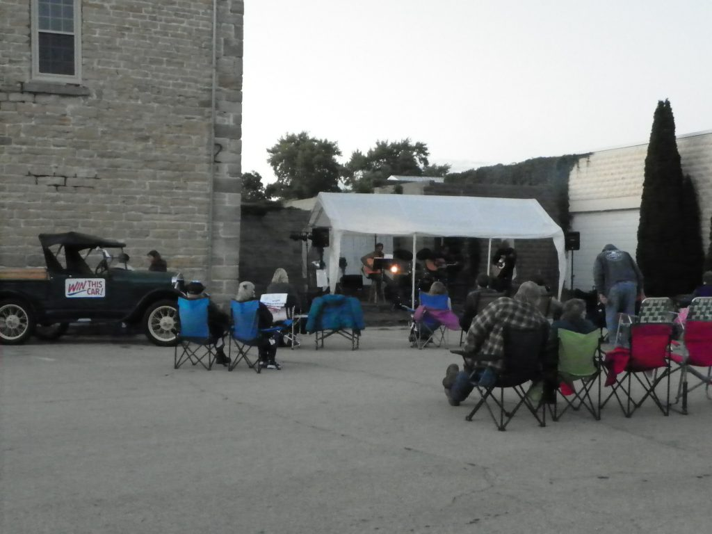 Audience in lawn chairs for Third Friday music