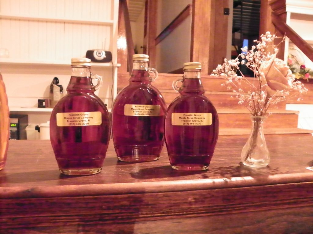 maple syrup in clear, glass bottles