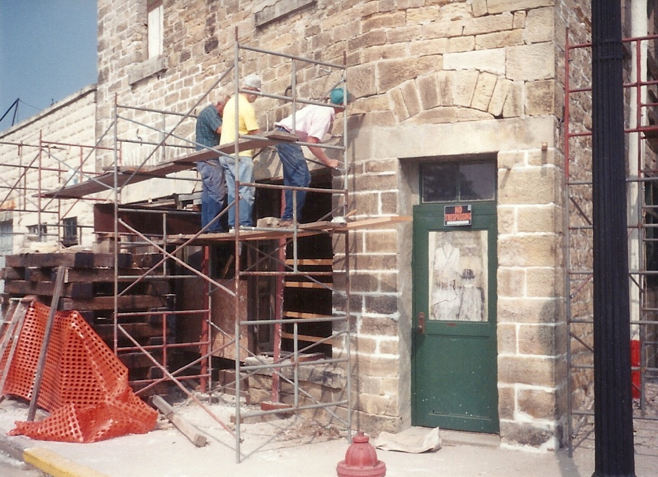 Workers on scaffold outside the front of the Lincoln Building